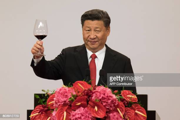 CORRECTION China's President Xi Jinping makes a toast during a banquet in Hong Kong on June 30 2017 China's President Xi Jinping addressed a...