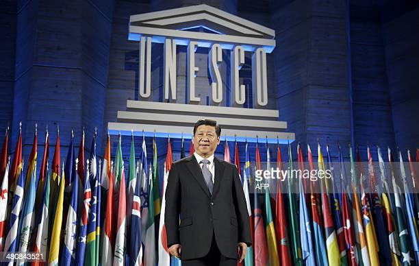 China's President Xi Jinping poses after delivering his speech at the UNESCO headquarters in Paris on March 27 2014 After a day devoted to...