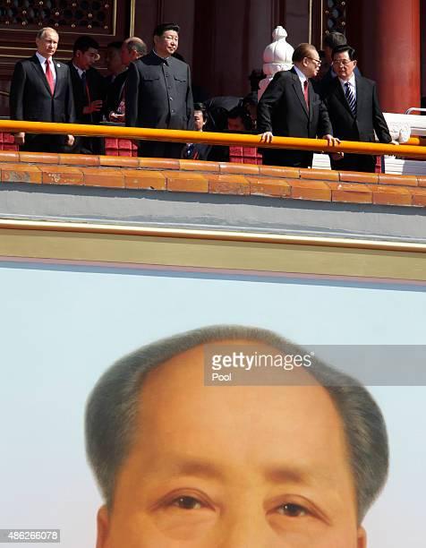 China's President Xi Jinping Russian President Vladimir Putin former Chinese President Jiang Zemin and former Chinese President Hu Jintao are seen on...