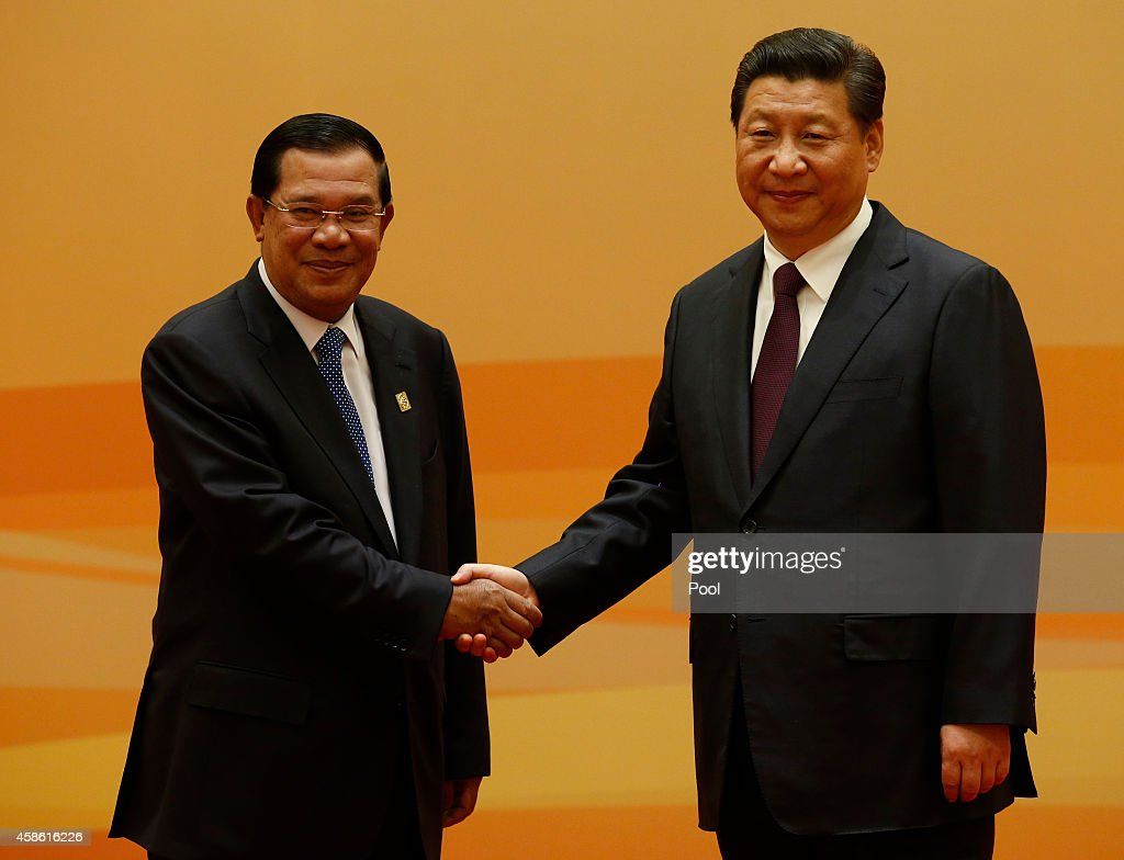 China's President <a gi-track='captionPersonalityLinkClicked' href=/galleries/search?phrase=Xi+Jinping&family=editorial&specificpeople=2598986 ng-click='$event.stopPropagation()'>Xi Jinping</a> (R) shakes hands with Cambodia's Prime Minister <a gi-track='captionPersonalityLinkClicked' href=/galleries/search?phrase=Hun+Sen&family=editorial&specificpeople=224084 ng-click='$event.stopPropagation()'>Hun Sen</a> at their family photo session prior to the Dialogue On Strengthening Connectivity Partnership at the Diaoyutai State Guesthouse on November 8, 2014 in Beijing, China.