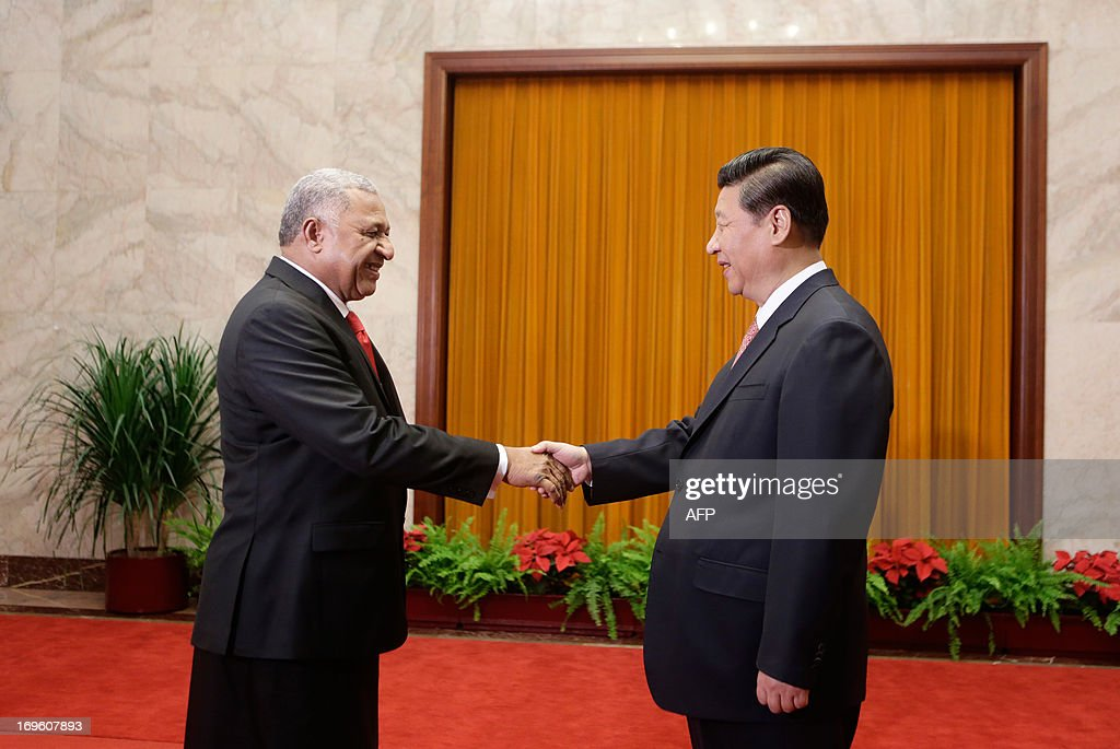 China's President Xi Jinping (R) shakes hands with Fiji's Prime Minister Josaia V. Bainimarama (L) during a meeting at the Great Hall of the People in Beijing on May 29, 2013. AFP PHOTO / POOL / Jason Lee