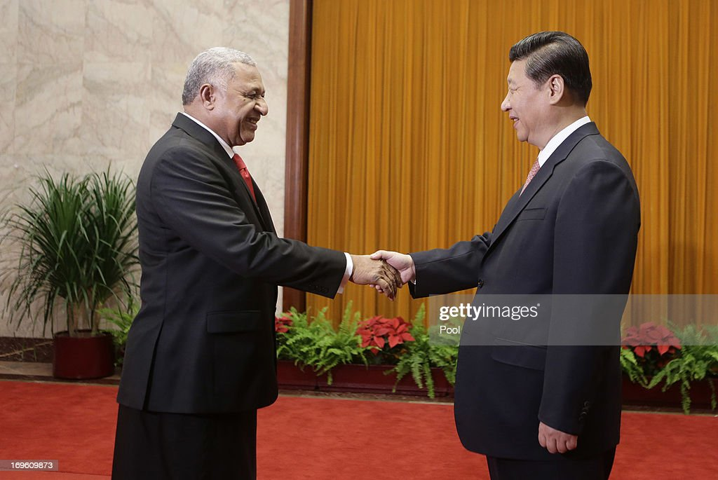 China's President Xi Jinping (R) shakes hands with Fiji's Prime Minister Josaia V. Bainimarama (L) during a meeting at the Great Hall of the People on May 29, 2013 in Beijing, China.