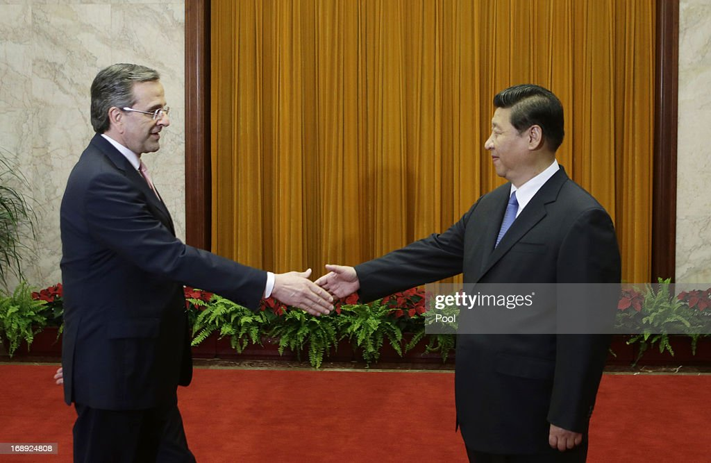 China's President Xi Jinping shakes hands with Greece's Prime Minister Antonis Samaras (L) during a meeting at the Great Hall of the People in Beijing, May 17, 2013. Greece is willing to roll out the 'red carpet' according to Samaras if China was willing to invest in the Greek economy.