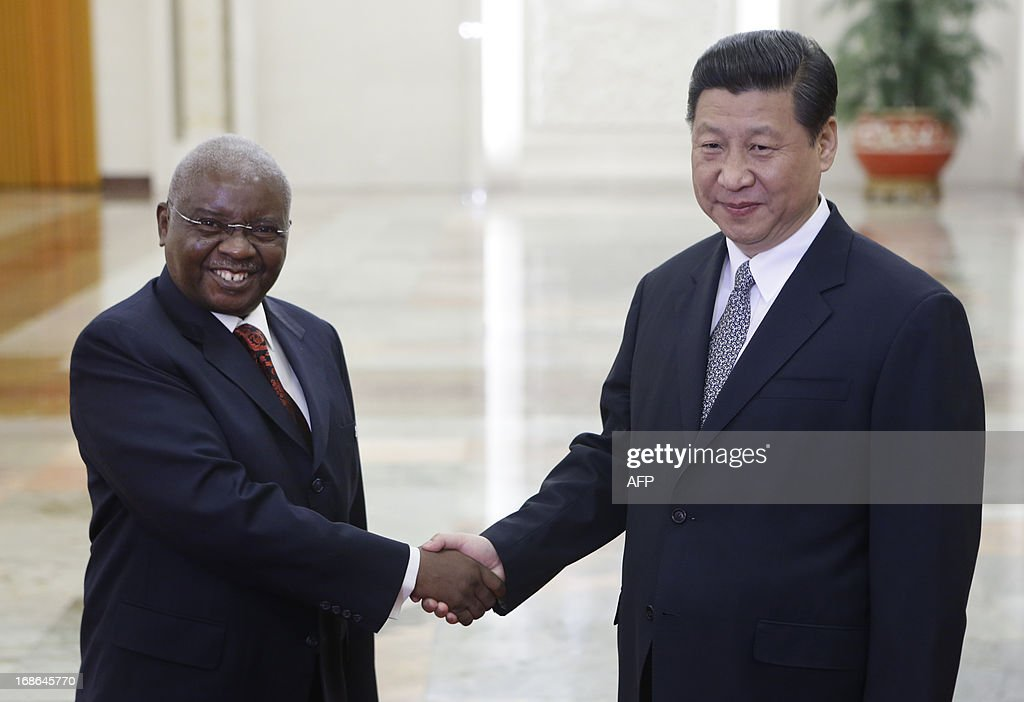 China's President Xi Jinping (R) shakes hands with his Mozambican counterpart Armando Guebuza (L) during a meeting at the Great Hall of the People in Beijing on May 13, 2013.