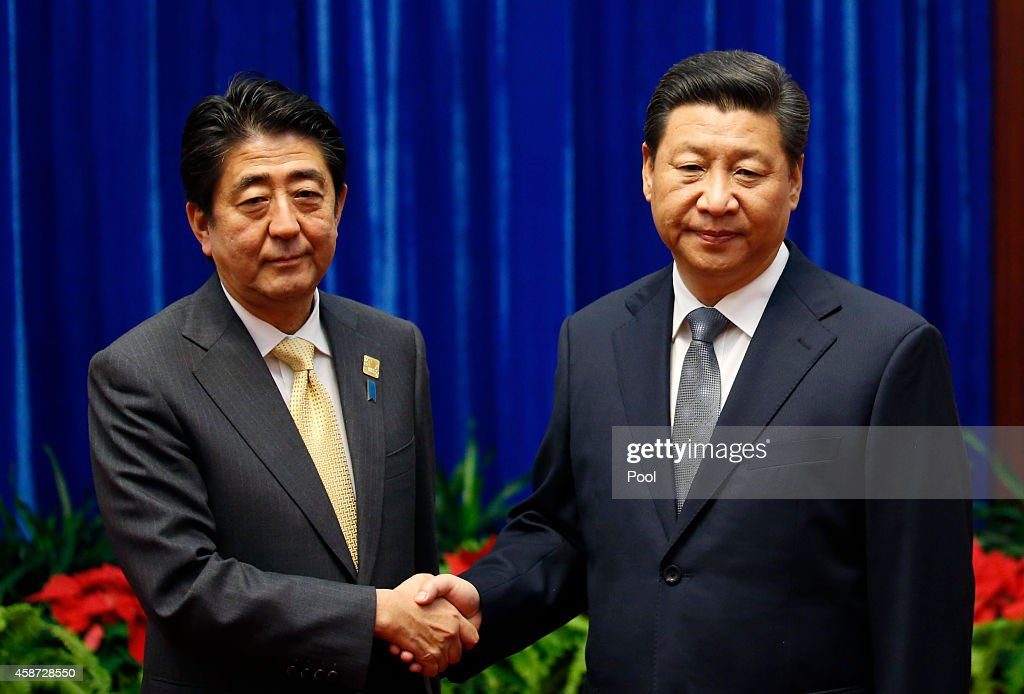 China's President <a gi-track='captionPersonalityLinkClicked' href=/galleries/search?phrase=Xi+Jinping&family=editorial&specificpeople=2598986 ng-click='$event.stopPropagation()'>Xi Jinping</a> (R) shakes hands with Japan's Prime Minister <a gi-track='captionPersonalityLinkClicked' href=/galleries/search?phrase=Shinzo+Abe&family=editorial&specificpeople=559017 ng-click='$event.stopPropagation()'>Shinzo Abe</a>, during their meeting at the Great Hall of the People, on the sidelines of the Asia Pacific Economic Cooperation (APEC) meetings, November 10, 2014 in Beijing, China. APEC Economic Leaders' Meetings and APEC summit is being held at Beijing's outskirt Yanqi Lake.