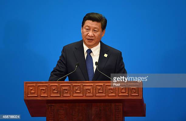 China's President Xi Jinping speaks at the closing press conference of the AsianPacific Economy Cooperation Summit outside of Beijing China APEC is a...