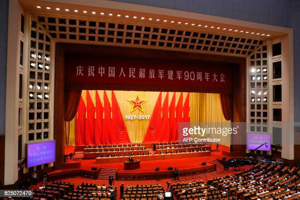 China's President Xi Jinping speaks during a ceremony to commemorate the 90th anniversary of the founding of the People's Liberation Army at the...