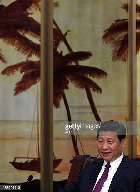 China's President Xi Jinping speaks during a meeting with Microsoft founder Bill Gates during the Boao Forum for Asia annual conference in Boao on...