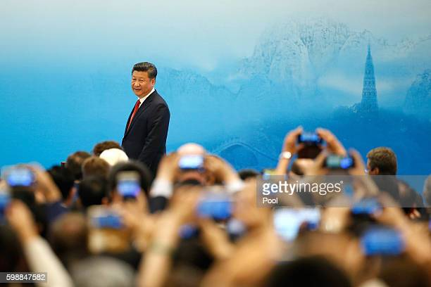 China's President Xi Jinping speaks during the opening ceremony of B20 Summit ahead of G20 Summit on September 3 2016 in Hangzhou China