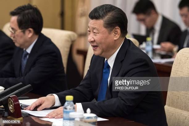 China's President Xi Jinping speaks to Canada's Prime Minister Justin Trudeau during a meeting at the Diaoyutai State Guesthouse in Beijing on...