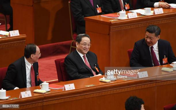 China's President Xi Jinping talks to Yu Zhengsheng Chairman of the National Committee of the Chinese People's Political Consultative Conference and...
