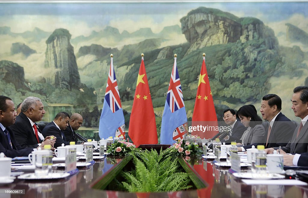 China's President Xi Jinping (2nd R) talks with Fiji's Prime Minister Josaia V. Bainimarama (2nd L) during a meeting at the Great Hall of the People on May 29, 2013 in Beijing, China.