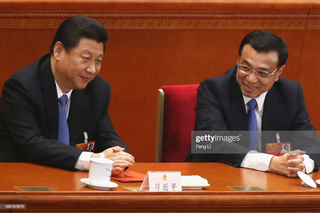 China's President <a gi-track='captionPersonalityLinkClicked' href=/galleries/search?phrase=Xi+Jinping&family=editorial&specificpeople=2598986 ng-click='$event.stopPropagation()'>Xi Jinping</a> (L) talks with Premier <a gi-track='captionPersonalityLinkClicked' href=/galleries/search?phrase=Li+Keqiang&family=editorial&specificpeople=2481781 ng-click='$event.stopPropagation()'>Li Keqiang</a> (R) during the sixth plenary meeting of the National People's Congress at the Great Hall of the People on March 16, 2013 in Beijing, China. The new lineup of China's State Council, nominated by Premier <a gi-track='captionPersonalityLinkClicked' href=/galleries/search?phrase=Li+Keqiang&family=editorial&specificpeople=2481781 ng-click='$event.stopPropagation()'>Li Keqiang</a>, was endorsed by lawmakers at the ongoing national legislative session Saturday afternoon.