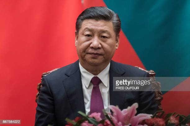 China's President Xi Jinping waits during a signing ceremony with Maldives' President Abdulla Yameen at the Great Hall of the People in Beijing on...