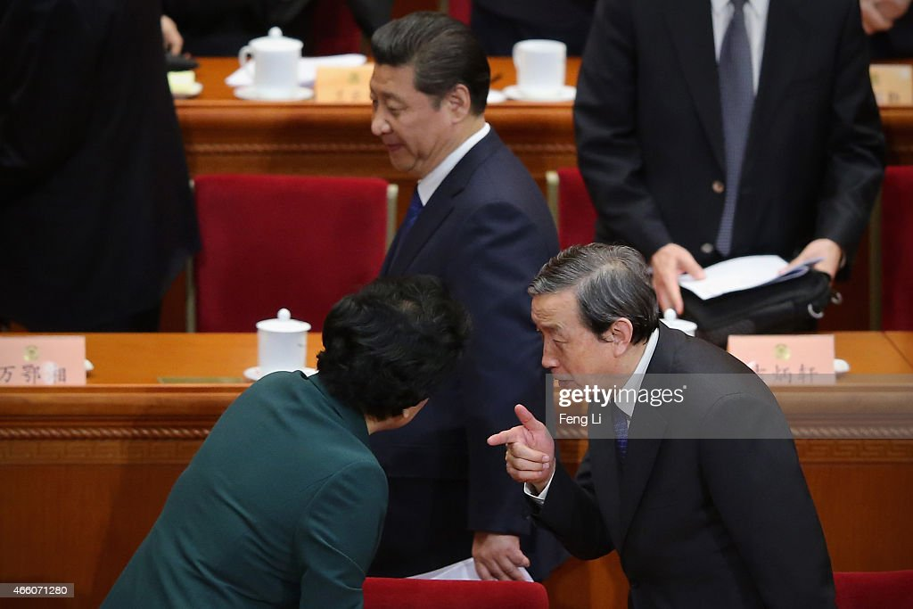 China's President Xi Jinping (Top) walks past as Vice Premier Ma Kai (R) speaks to Vice Premier Liu Yandong after the closing session of the Chinese People's Political Consultative Conference at the Great Hall of the People on March 13, 2015 in Beijing, China. Over 2,000 members of the 12th National Committee of the Chinese People's Political Consultative, a political advisory body, are attending the annual session, during which they will discuss the development of China.