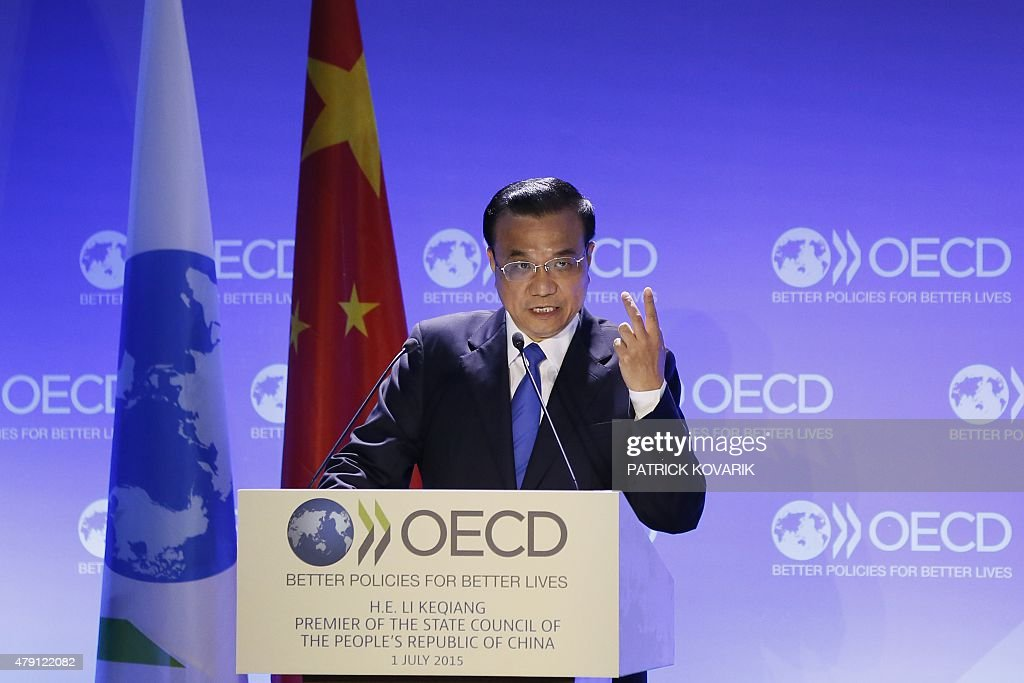 China's Prime Minister Li Keqiang delivers a speech at the OECD in Paris on July 1 2015 AFP PHOTO / PATRICK KOVARIK
