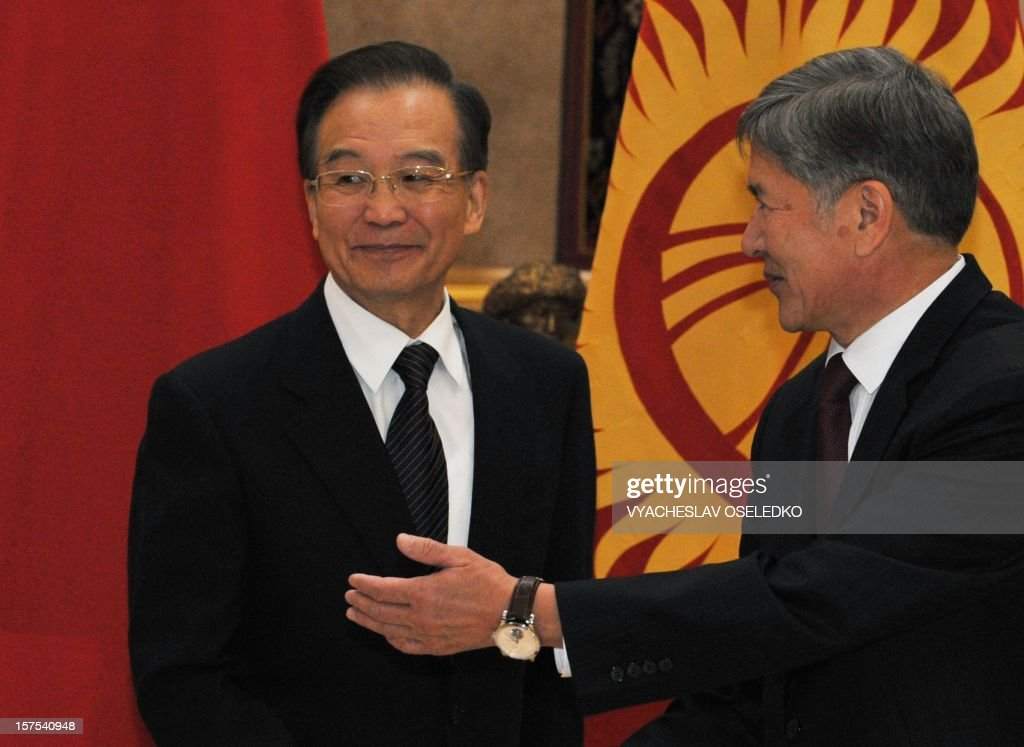 China's Prime Minister Wen Jiabao (L) and Kyrgyz President Almazbek Atambayev (R) meeting in the Kyrgyz capital Bishkek, on December 4, 2012. Chinese Prime Minister Wen Jiabao arrived today in Bishkek to hold talks with Kyrgyz leaders as China seeks to bolster its influence in strategic Central Asia with an eye on its natural resources. AFP PHOTO / VYACHESLAV OSELEDKO