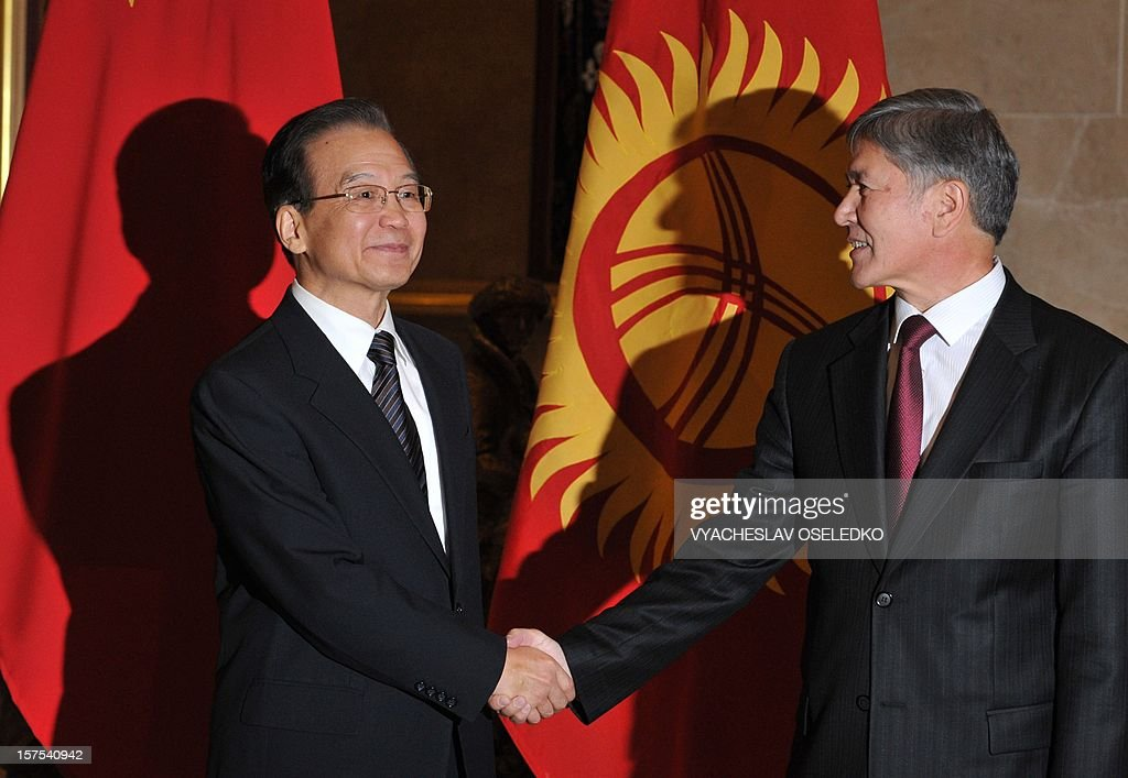 China's Prime Minister Wen Jiabao (L) shakes hands with Kyrgyz President Almazbek Atambayev (R) during their meeting in the Kyrgyz capital Bishkek, on December 4, 2012. Chinese Prime Minister Wen Jiabao arrived today in Bishkek to hold talks with Kyrgyz leaders as China seeks to bolster its influence in strategic Central Asia with an eye on its natural resources. AFP PHOTO / VYACHESLAV OSELEDKO