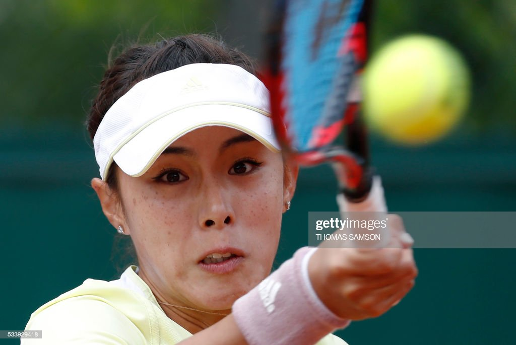 China's Qiang Wang returns the ball to France's Tessah Andrianjafitrimo during their women's first round match at the Roland Garros 2016 French Tennis Open in Paris on May 24, 2016. / AFP / THOMAS