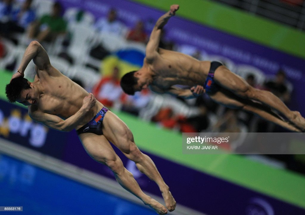 China's Qin Kai and Wang Feng compete in the men's 3m springboard synchronised diving final during the FINA Diving World Series 2009 at the Hamad...