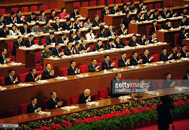China's ruling Communists applaud themselves inside the Great Hall of the People during a session of the National People's Congress its annual...