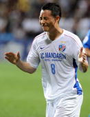 China's Shanghai Shenhua midfielder Chen Tao reacts after missing a score against Singapore Armed Forces FC during their AFC Champions League...