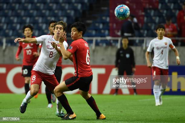China's Shanghai SIPG's Oscar fights for the ball with Japan's Urawa Red Diamonds' Wataru Endo during the Asian Champions League semifinal football...