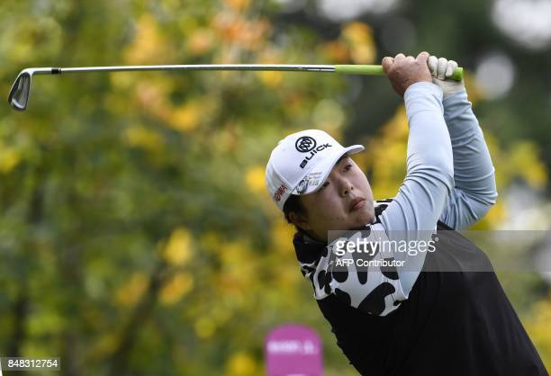 China's Shanshan Feng competes during the Evian Championship women's golf tournament on September 17 2017 in the French Alps town of EvianlesBains /...