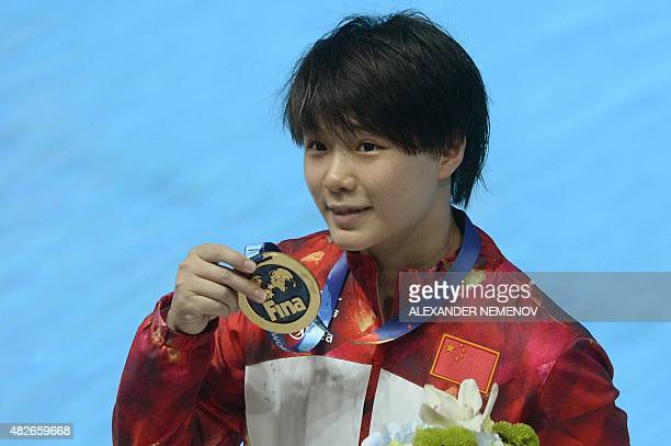 China's Shi Tingmao celebrates with her gold medal during the podium ceremony for the Women's 3m Springboard final diving event at the 2015 FINA...