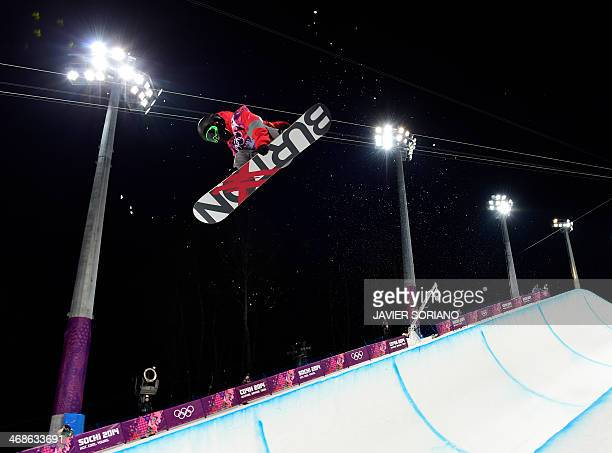 China's Shi Wancheng competes in the Men's Snowboard Halfpipe Semifinals at the Rosa Khutor Extreme Park during the Sochi Winter Olympics on February...