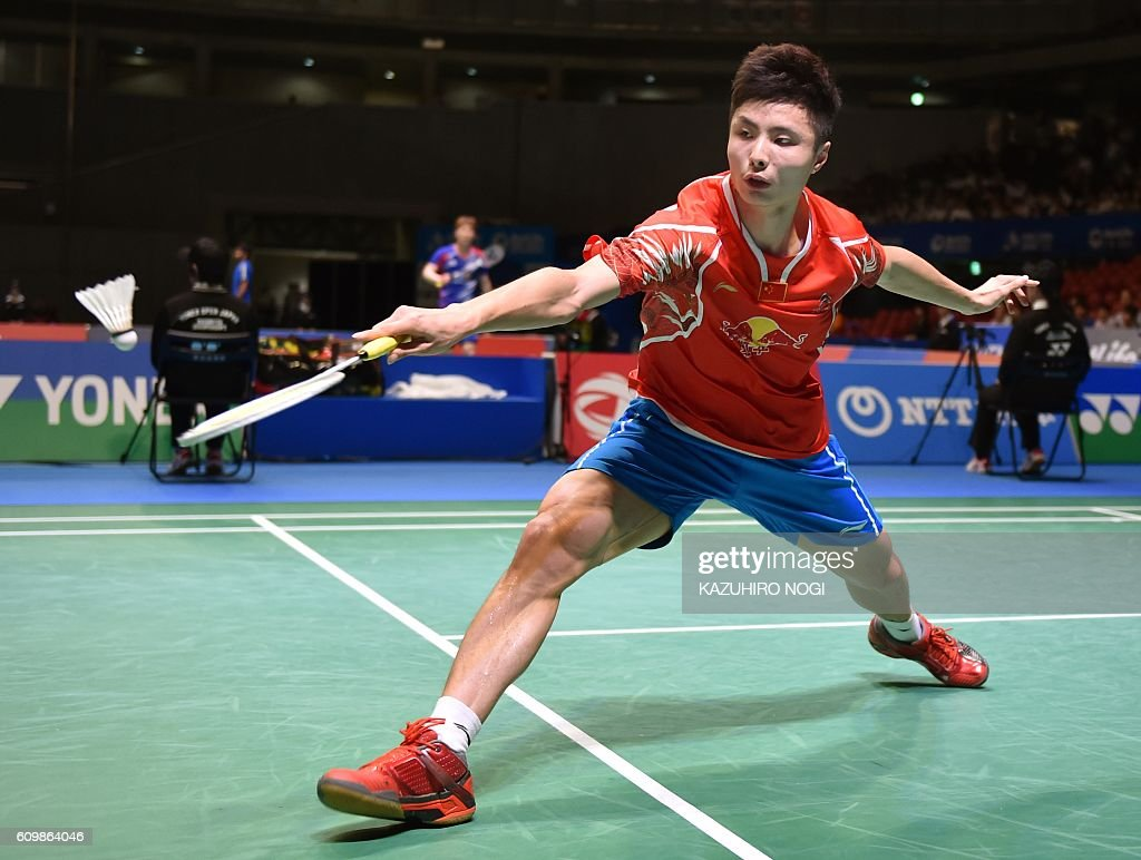 China s Shi Yuqi hits a return against Lee Chong Wei of Malaysia