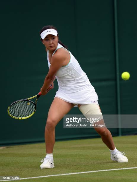 China's Shuai Peng in action against Great Britain's Johanna Konta during day one of the Wimbledon Championships at the All England Lawn Tennis and...