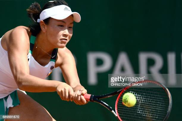 China's Shuai Peng returns the ball to Romania's Sorana Cirstea during their tennis match at the Roland Garros 2017 French Open on May 30 2017 in...