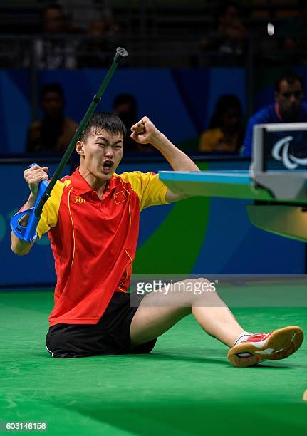 China's Shuo Yan celebrates winning 31 against Spain's Jordi Morales Garcia in the Men's Singles Class 7 Bronze Medal tennis table match at the...