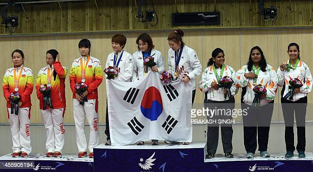 China's silver medalists Zhang Jingjing Chen Ying and Zhou Qingyuan South Korea's gold medalists Lee JungEun Kim JangMi and JungHye Kwak and India's...