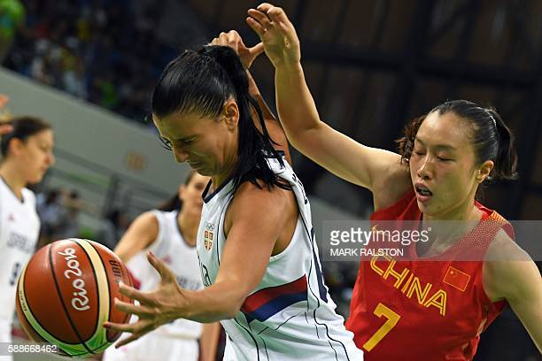 China's small forward Shao Ting holds off Serbia's shooting guard Ana Dabovic during a Women's round Group B basketball match between Serbia and...