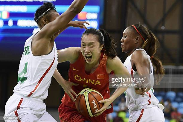 China's small forward Shao Ting is blocked by Senegal's centre Marie Sadio Rosche during a Women's round Group B basketball match between Senegal and...