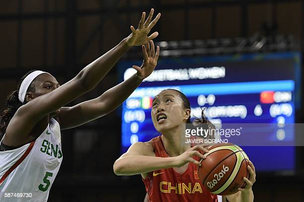 China's small forward Shao Ting is blocked by Senegal's forward Aya Traore during a Women's round Group B basketball match between Senegal and China...