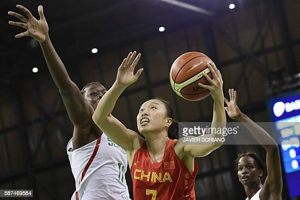 China's small forward Shao Ting jumps for a basket by Senegal's centre Maimouna Diarra during a Women's round Group B basketball match between...