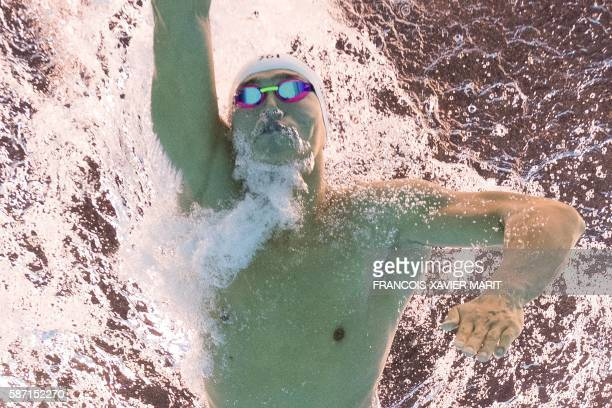 China's Sun Yang takes part in the Men's 200m Freestyle Semifinal during the swimming event at the Rio 2016 Olympic Games at the Olympic Aquatics...