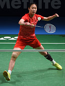 China's Sun Yu hits a return against China's Li Xuerui during the women's singles semifinal at the Australian Open badminton tournament in Sydney on...