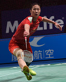 China's Sun Yu hits a return to India's Saina Nehwal during their women's singles final at the Australian Open Badminton tournament in Sydney on June...