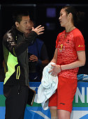 China's Sun Yu listen to her coach former world champion Chen Jin during the women's singles final against India's Saina Nehwal at the Australian...