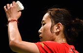 China's Sun Yu prepares to serve against China's Li Xuerui in the women's singles semifinal at the Australian Open badminton tournament in Sydney on...