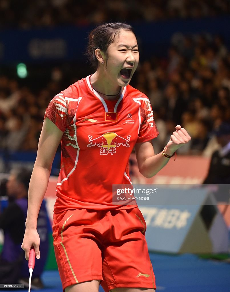 China s Sun Yu reacts following her point against Japan s Sayaka