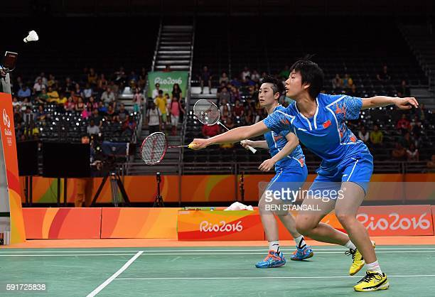 China's Tang Yuanting and China's Yu Yang returns against South Korea's Jung Kyung Eun and South Korea's Shin Seung Chan during their women's doubles...