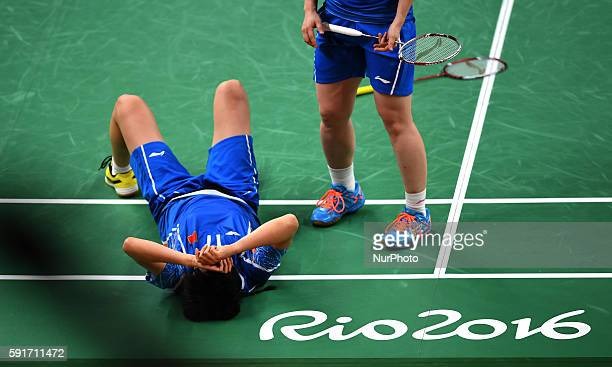 China's Tang Yuanting and Yu Yang compete during the women's doubles semifinal of badminton against Denmark's Christinna Pedersen and Kamilla Rytter...
