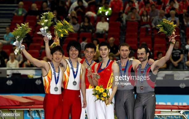 China's team of Tu Xiao and Dong Dong celebrate with their gold medals alongside Japan's team of Takashi Sakamoto and Yasuchiro Ueyama with their...