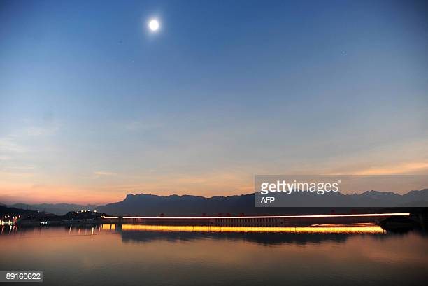 China's Three Gorges Dam lights up in Yichang in central China's Hubei province on July 22 as the lunar shadow or 'umbra' moves over the massive dam...