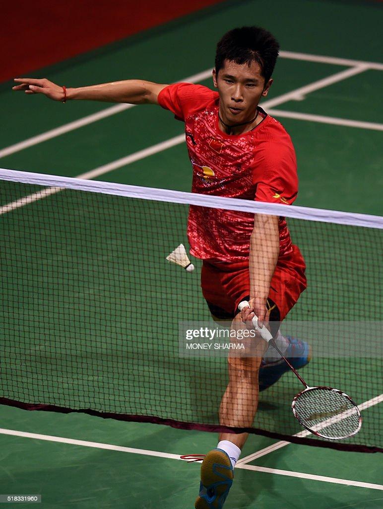 China s Tian Houwei plays a shot during the Yonex Sunrise India